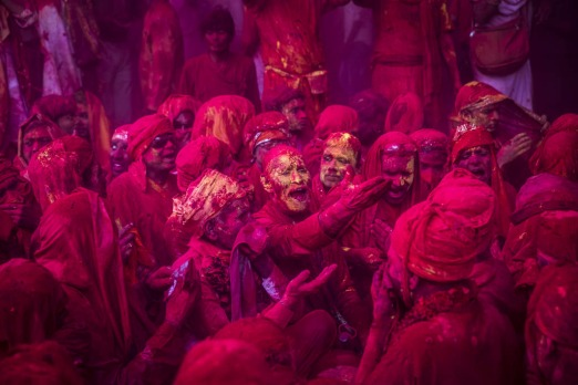 Hindu devotees play with colour during Lathmaar Holi celebrations in the village of Barsana, India.