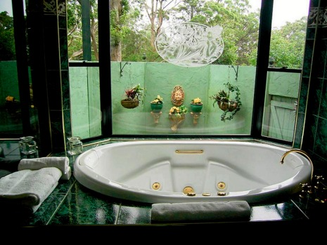 A spa overlooks surrounding rainforest and a small private garden.