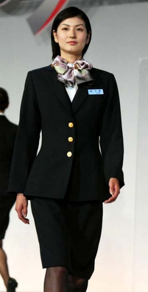 Impeccably groomed and always ready with a smile ... a Japan Airlines flight attendant.