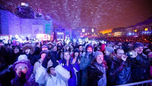 Crowds converge for the Montreal en Lumiere celebration.