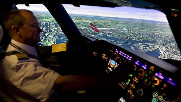 Flying low: Jim Eaglen in the flight simulator. The crew have flown the route dozens of times in simulators over the ...