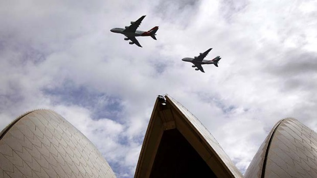 A Qantas (L) and an Emirates Airbus A380 fly in formation above the Sydney Opera House on Sunday to mark the commencement of the five-year alliance between the airlines.