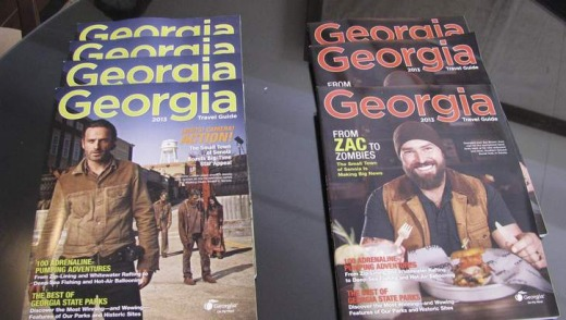 Two covers of the travel guide issued by the states of Georgia feature the TV show The Walking Dead.