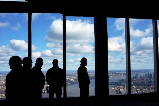 New York Port Authority officials unveil the stunning view from the top of One World Trade Centre, a 360-degree eagle's ...