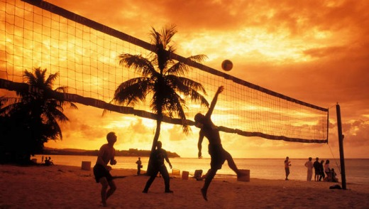 Someone's got to do it: A volleyball game at Tumon Bay.