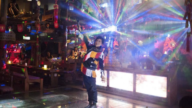 Party people: A man in Naxi dress performs.