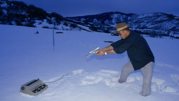 Hunter S Thompson shooting his typewriter.