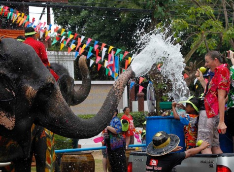 Elephants spray water at tourists in celebration of the Songkran water festival in Thailand's Ayutthaya province, about ...