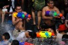 Revellers use water guns as they participate in a water fight during Songkran Festival celebrations at Silom road in Bangkok.