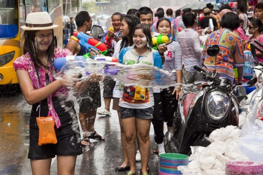 A woman reacts to being soaked by water during a community water fight as part of the Songkran water festival in Bangkok.