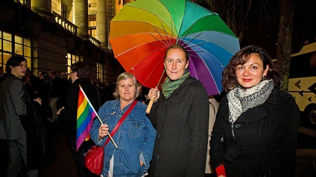 True colours: Supporters of the same-sex marriage laws wait outside parliament building in Wellington. The act is ...
