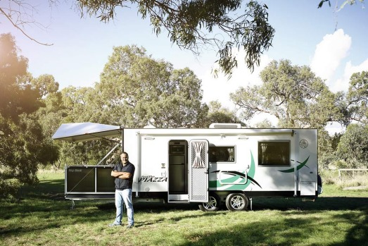 Bill Deralas with a Royal Flair Piazza caravan in Tullamarine.