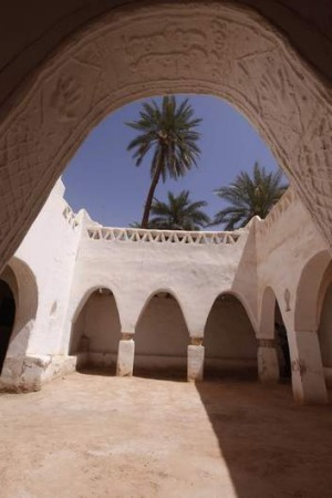 The arch that leads into a courtyard inside the enclosed old town, a designated UNESCO World Heritage site, in the ...