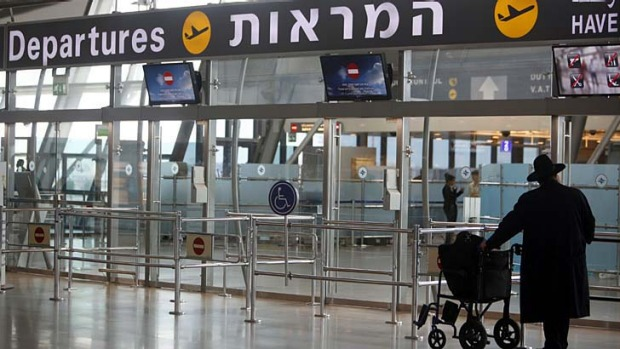 A passenger stands in the departure hall at Israel's Ben-Gurion International Airport near Tel Aviv. Security officials ...