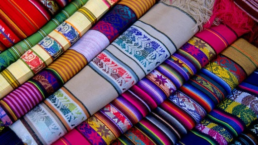 The Otavalo markets are abound with colourful rugs.