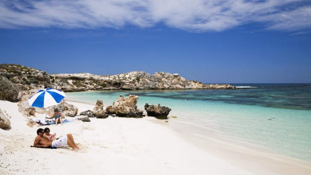 Sunbathers on beach at Salmon Bay. Rottnest island, WA.