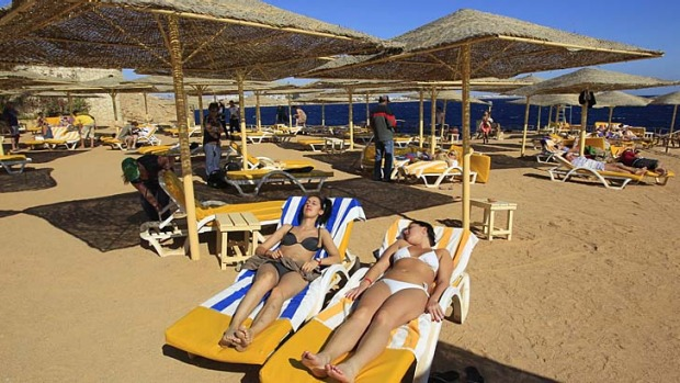 'Bikinis are welcome' ... tourists enjoy the beach in the Red Sea resort town of Sharm el-Sheikh, some 500 kilometres ...