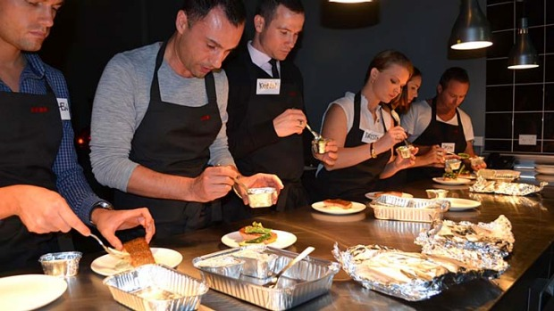Plating up ... Virgin Australia flight attendants learn how to serve items from Luke Mangan's in-flight menu at the ...