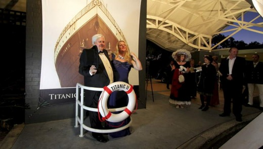 Clive Palmer poses with guests at the Captain's Atlantic Dinner as part of the week-long Titanic Culinary Journey at the ...