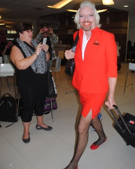 Sir Richard Branson was in Perth to make good on a lost bet to be a stewardess on board an Air Asia flight.