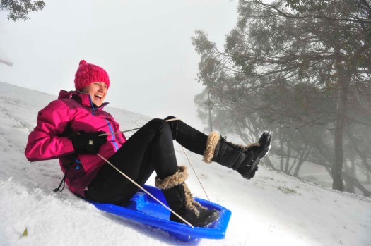 Kelly Purton gets some early toboggan practice in at Mt Buller.