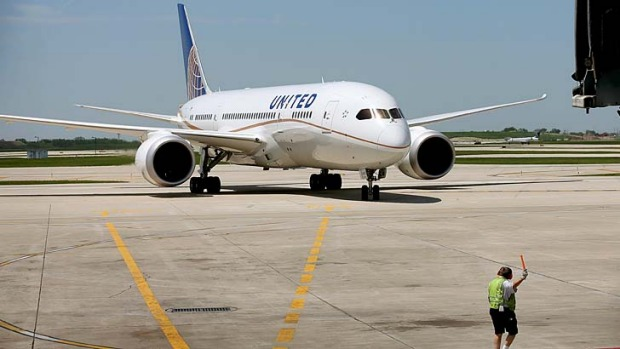 A United Airlines Boeing 787 Dreamliner taxis to a gate at Chicago's O'Hare International Airport after taking off from Houston on the airline's first Dreamliner flight since the aircraft were grounded in January due to battery problems.