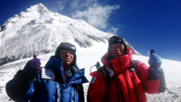 Yuichiro Miura (right) and his son Gota leave the C4 camp to ascent to the summit of Mount Everest.