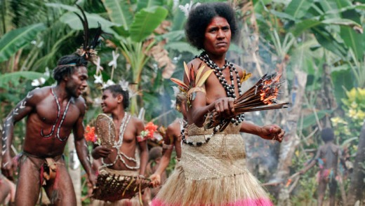 Women in traditional dress performing a Small Nambas ritual fire dance.