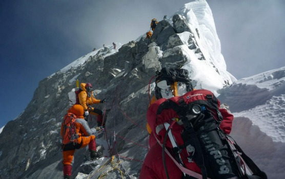 In this file photograph taken on May 19, 2009, unidentified mountaineers walk past the Hillary Step while pushing for ...