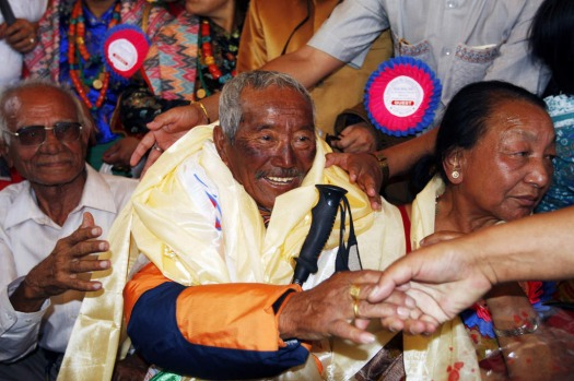 In this May 31, 2008 file photo, Min Bahadur Sherchan, center, who became the oldest person to climb Mount Everest on ...