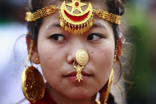 A woman wearing traditional ornaments participates in a parade marking the 60th anniversary of Sir Edmund Hillary and ...
