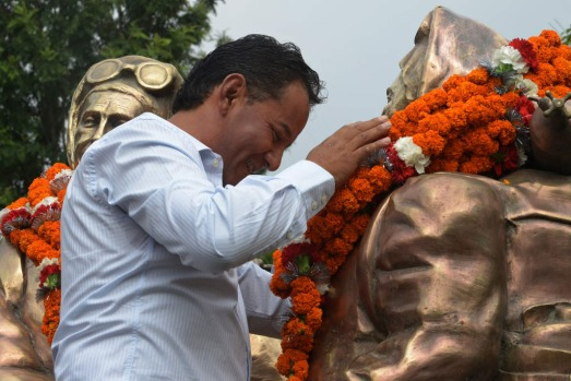 Tashi Tenzing, grandson of mountaineer Tenzing Norgay Sherpa, offer garlands to the statues of Tenzing and Edmund ...