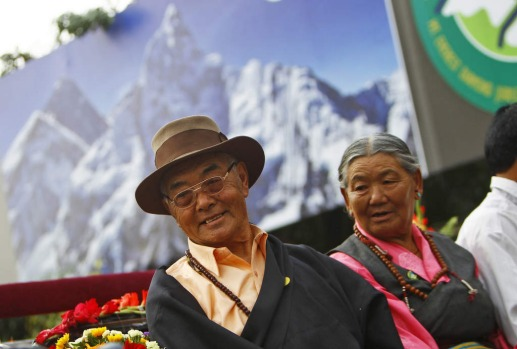 Kancha Sherpa, left, the only survivor of the first successful expedition to Mount Everest participates in a function to ...