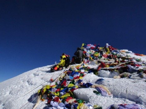 In this photograph taken on May 23, 2013 unidentified mountaineers look out from the summit of Mount Everest.  Nepal ...