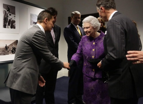 Queen Elizabeth II meeting Nepalese Sherpa mountain climber Jamling Norgay, left, son of Tenzing Norgay, during a ...