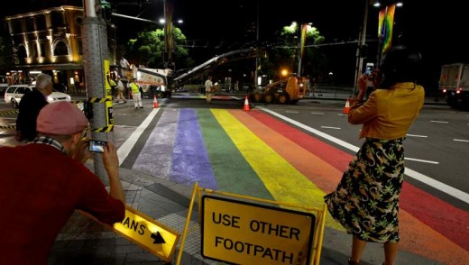 Roadworkers ripping up the rainbow crossing at Taylor Square in Sydney.