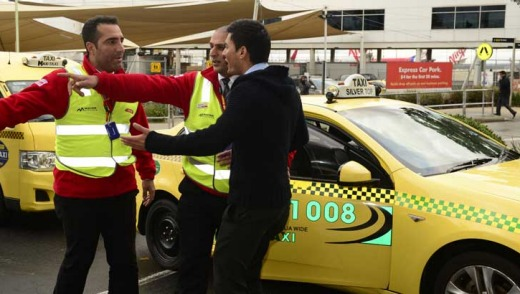 A taxi driver exchanges words with security at Melbourne Aipport this morning.