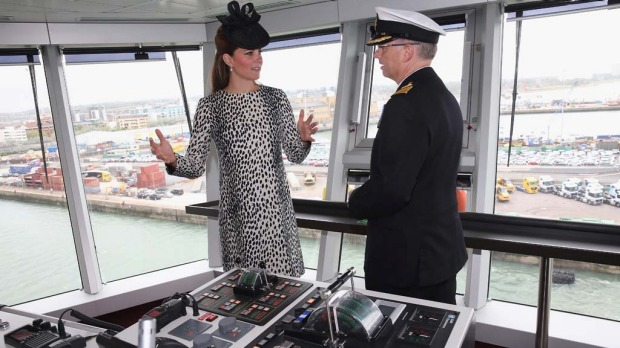 Britain's Duchess of Cambridge receives an on board tour with Captain Tony Draper during the Princess Cruises ship naming ceremony to officially name the new Royal Princess.