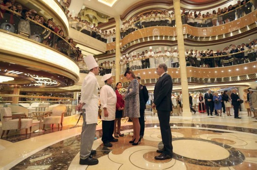 Britain's Catherine, Duchess of Cambridge (C) meets staff after a naming ceremony for the 'Royal Princess' cruise ship ...