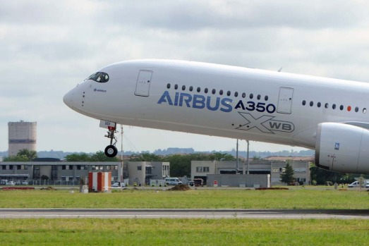 Airbus's next-generation A350 plane takes off from Toulouse-Blagnac airport, southwestern France, on its first test ...
