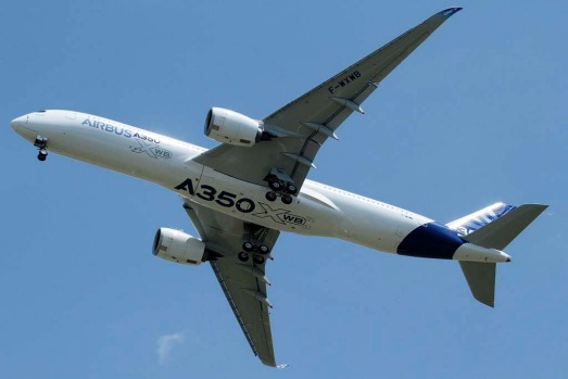 The new Airbus A350 flies over Toulouse-Blagnac airport during its maiden flight in southwestern France.