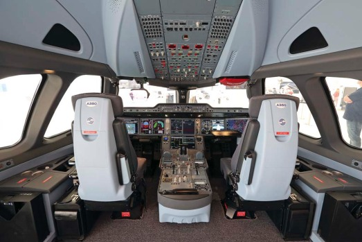 A mock-up of an Airbus SAS A350 aircraft cockpit stands on display prior to the opening of the Paris Air Show in Paris, ...