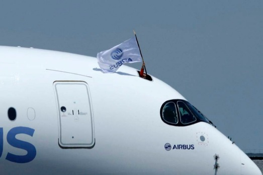 A pilot waves a flag after the landing of the new Airbus A350 at Toulouse-Blagnac airport, after its maiden flight in ...