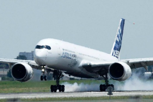 The new Airbus A350 lands at Toulouse-Blagnac airport after its maiden flight in southwestern France.