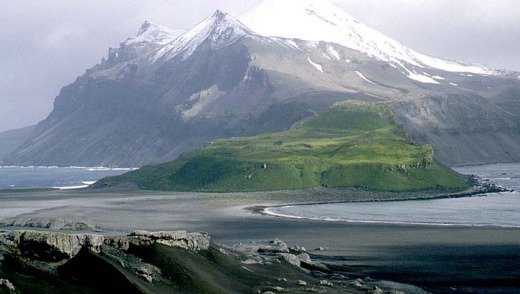 Effectively a big volcano in the middle of nowhere ? it's about 1000km north of Antarctica, and more than 4000km from ...