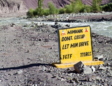 Road sign on the Manali-Leh highway, India.