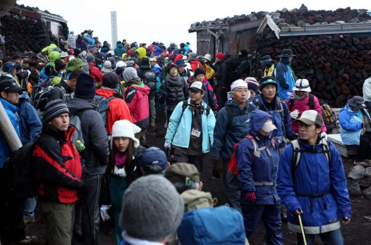 The summit is crowded with climbers on the first day of the climbing season.