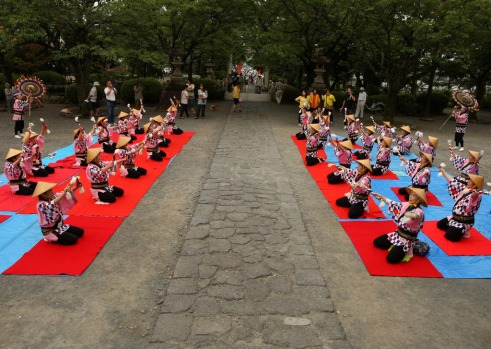 Japanese women perform traditional dance during the official opening ceremony of Mount Fuji climbing season.