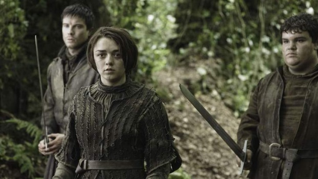 Maisie Williams as Arya Stark, roaming the woods of Westeros (Northern Ireland).