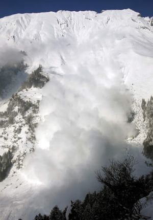 An avalanche sweeps downhill in the Vallee de la Sionne, Switzerland.